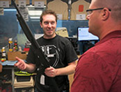 staff member demonstrates a shotgun